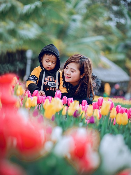 Woman and Toddler with Flowers