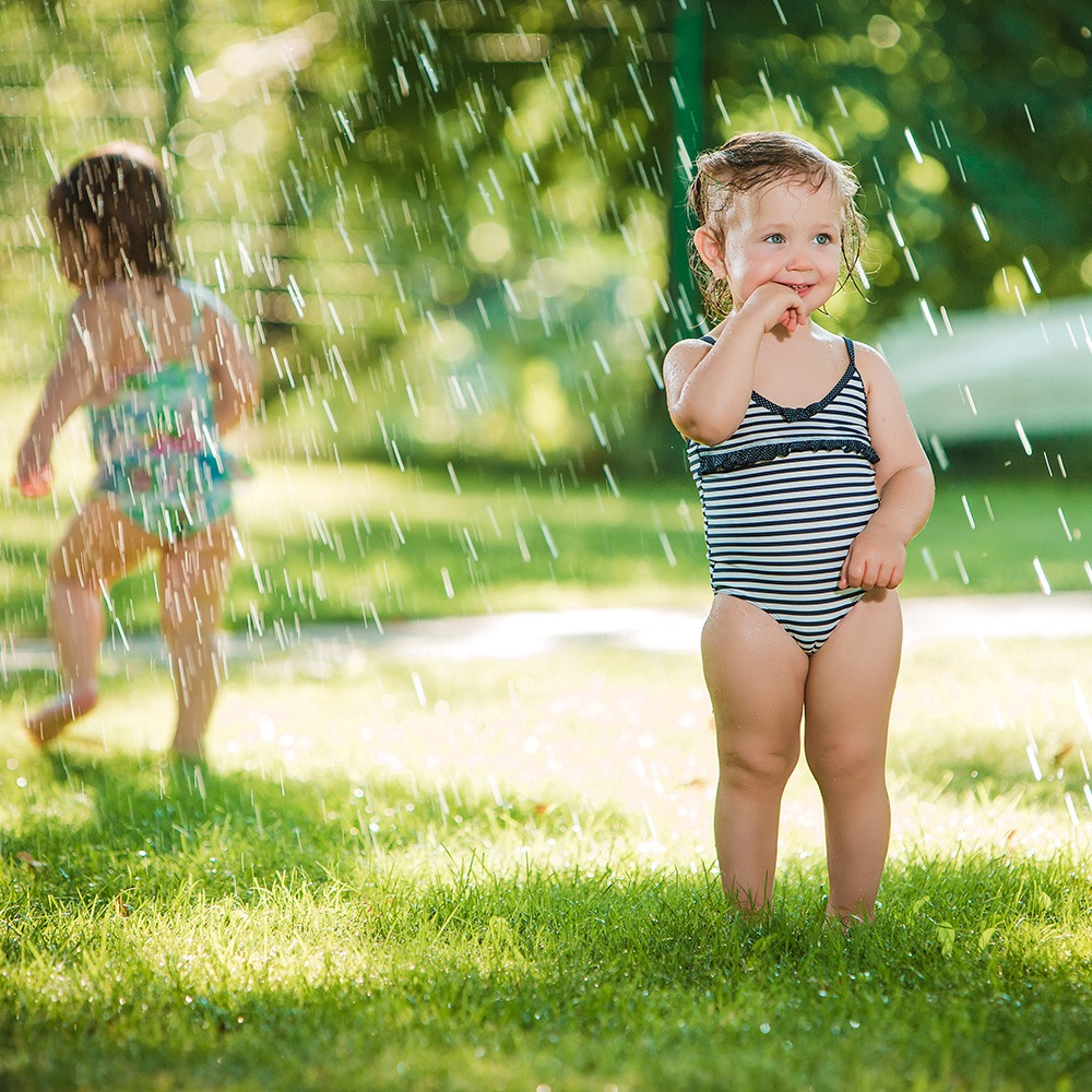 Little Girls on Lawn with Sprinkler